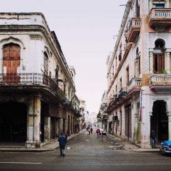 Street scene with vintage car in Havana, Cuba